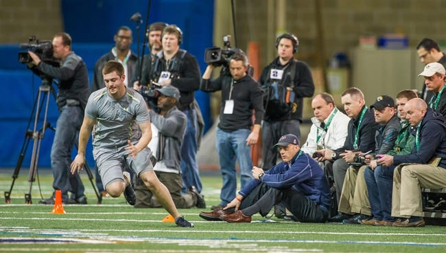 Mar 20, 2014; Notre Dame, IN, USA; Notre Dame Fighting Irish former football player Tommy Rees runs a drill during Notre Dame pro day at the Guglielmino Athletics Complex. Mandatory Credit: Matt Cashore-USA TODAY Sports