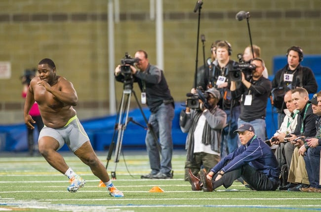 Mar 20, 2014; Notre Dame, IN, USA; Notre Dame Fighting Irish former football player Louis Nix runs a drill during Notre Dame pro day at the Guglielmino Athletics Complex. Mandatory Credit: Matt Cashore-USA TODAY Sports
