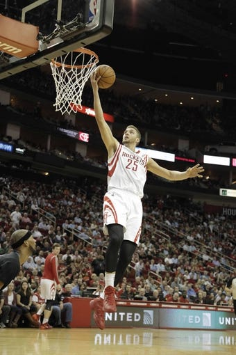 Mar 20, 2014; Houston, TX, USA; Houston Rockets forward Chandler Parsons (25) shoots the ballduring the second quarter against the Minnesota Timberwolves at Toyota Center. Mandatory Credit: Andrew Richardson-USA TODAY Sports