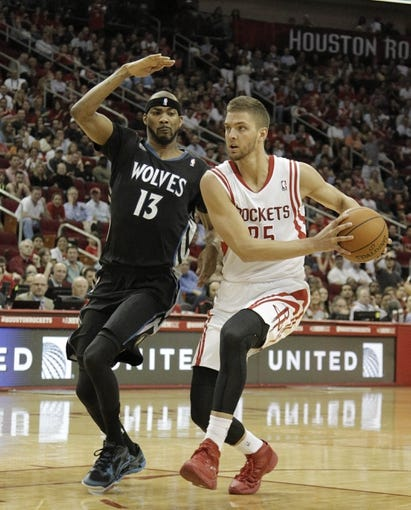 Mar 20, 2014; Houston, TX, USA; Houston Rockets forward Chandler Parsons (25) drives to the basket against Minnesota Timberwolves forward Corey Brewer (13) during the second quarter at Toyota Center. Mandatory Credit: Andrew Richardson-USA TODAY Sports