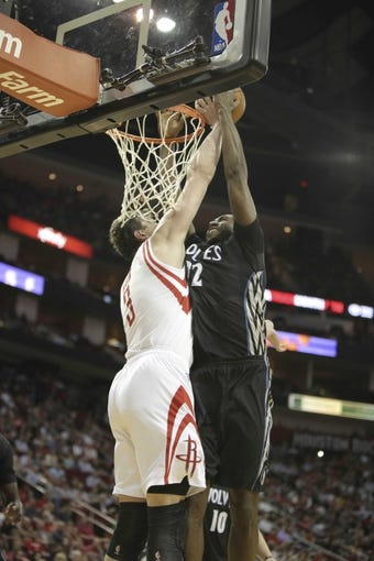 Mar 20, 2014; Houston, TX, USA; Houston Rockets center Omer Asik (3) blocks the shot of Minnesota Timberwolves forward Luc Richard Mbah a Moute (12) during the third quarter at Toyota Center. Mandatory Credit: Andrew Richardson-USA TODAY Sports