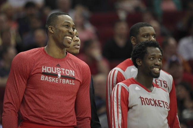 Mar 20, 2014; Houston, TX, USA; Houston Rockets center Dwight Howard (12) and guard Patrick Beverley (2) reacts to a play during the fourth quarter against the Minnesota Timberwolves at Toyota Center. Mandatory Credit: Andrew Richardson-USA TODAY Sports