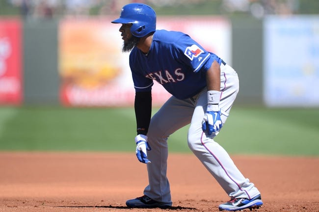 Mar 22, 2014; Surprise, AZ, USA; Texas Rangers shortstop Elvis Andrus (1) leads off of first base against the Kansas City Royals at Surprise Stadium. The Royals won 8-4. Mandatory Credit: Joe Camporeale-USA TODAY Sports