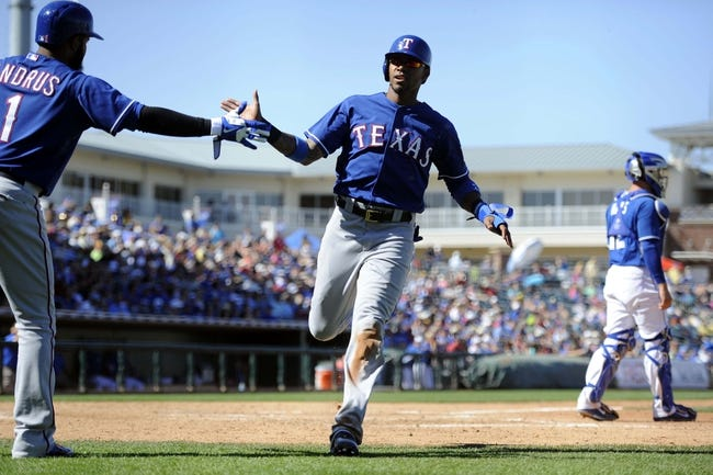 Mar 22, 2014; Surprise, AZ, USA; Texas Rangers center fielder Engel Beltre (43) scores a run in the seven inning and is high fived by Texas Rangers shortstop Elvis Andrus (1) against the Kansas City Royals at Surprise Stadium. The Royals won 8-4. Mandatory Credit: Joe Camporeale-USA TODAY Sports
