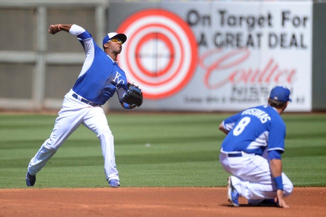 Mar 22, 2014; Surprise, AZ, USA; Kansas City Royals shortstop Alcides Escobar (2) throws out a Texas Rangers runner at first base in the second inning at Surprise Stadium. The Royals won 8-4. Mandatory Credit: Joe Camporeale-USA TODAY Sports