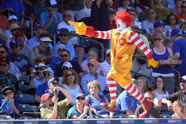 Mar 22, 2014; Surprise, AZ, USA; Ronald McDonald entertains fans during innings between the Kansas City Royals and the Texas Rangers at Surprise Stadium. The Royals won 8-4. Mandatory Credit: Joe Camporeale-USA TODAY Sports
