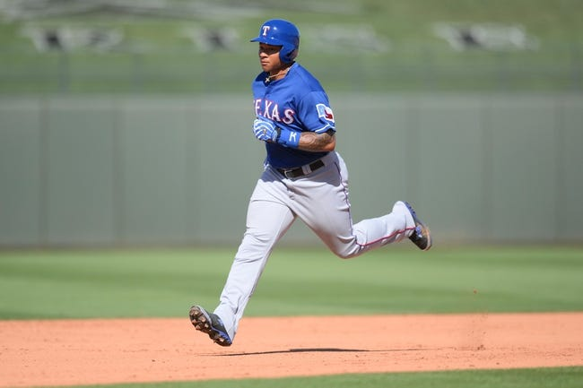 Mar 22, 2014; Surprise, AZ, USA; Texas Rangers center fielder Michael Choice (15) runs the bases after hitting a home run in the eighth inning against the Kansas City Royals at Surprise Stadium. The Royals won 8-4. Mandatory Credit: Joe Camporeale-USA TODAY Sports
