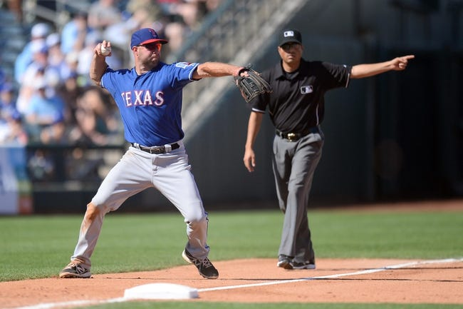 Mar 22, 2014; Surprise, AZ, USA; Texas Rangers third baseman Kevin Kouzmanoff (6) attempts a force out at second base in the seventh inning against the Kansas City Royals at Surprise Stadium. The Royals won 8-4. Mandatory Credit: Joe Camporeale-USA TODAY Sports