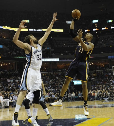 Mar 22, 2014; Memphis, TN, USA; Indiana Pacers forward David West (21) shoots over Memphis Grizzlies center Marc Gasol (33) during the game at FedExForum. Mandatory Credit: Justin Ford-USA TODAY Sports