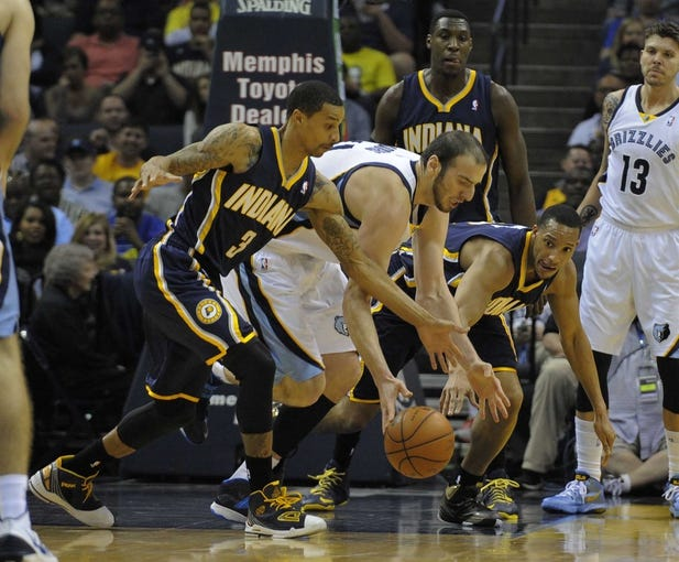 Mar 22, 2014; Memphis, TN, USA; Indiana Pacers guard George Hill (3) and Memphis Grizzlies center Kosta Koufos (41) fight for the ball during the game at FedExForum. Mandatory Credit: Justin Ford-USA TODAY Sports