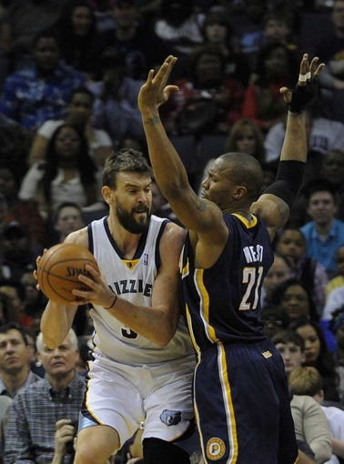 Mar 22, 2014; Memphis, TN, USA; Memphis Grizzlies center Marc Gasol (33) is guarded by Indiana Pacers forward David West (21) during the game at FedExForum. Mandatory Credit: Justin Ford-USA TODAY Sports