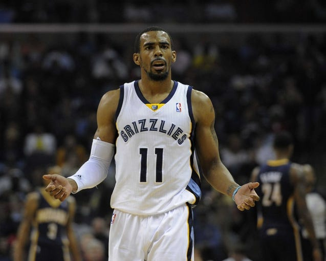 Mar 22, 2014; Memphis, TN, USA; Memphis Grizzlies guard Mike Conley (11) reacts to a call during the game against the Indiana Pacers at FedExForum. Mandatory Credit: Justin Ford-USA TODAY Sports
