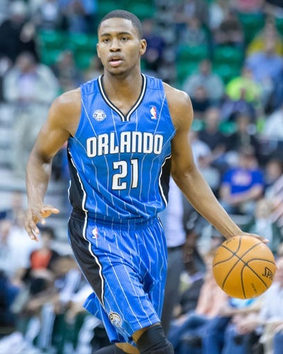 Mar 22, 2014; Salt Lake City, UT, USA; Orlando Magic forward Maurice Harkless (21) dribbles the ball during the first half against the Utah Jazz at EnergySolutions Arena. Mandatory Credit: Russ Isabella-USA TODAY Sports