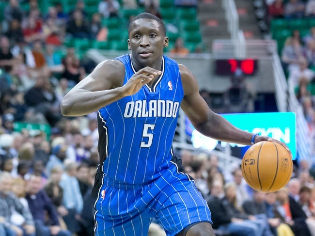 Mar 22, 2014; Salt Lake City, UT, USA; Orlando Magic guard Victor Oladipo (5) dribbles the ball during the first half against the Utah Jazz at EnergySolutions Arena. Mandatory Credit: Russ Isabella-USA TODAY Sports