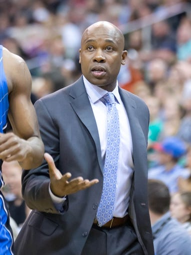Mar 22, 2014; Salt Lake City, UT, USA; Orlando Magic head coach Jacque Vaughn reacts during the first half against the Utah Jazz at EnergySolutions Arena. Mandatory Credit: Russ Isabella-USA TODAY Sports