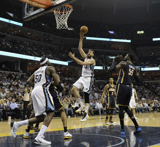 Mar 22, 2014; Memphis, TN, USA; Memphis Grizzlies center Marc Gasol (33) lays the ball up against Indiana Pacers at FedExForum. Memphis Grizzlies defeat the Indiana Pacers 82 - 71. Mandatory Credit: Justin Ford-USA TODAY Sports
