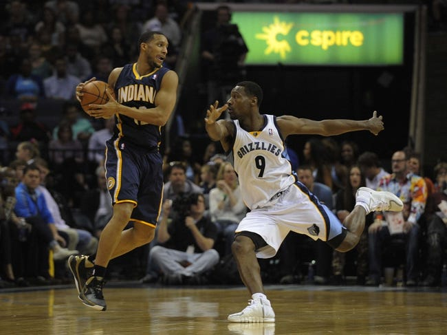 Mar 22, 2014; Memphis, TN, USA; Memphis Grizzlies guard Tony Allen (9) guards Indiana Pacers forward Evan Turner (12) during the game at FedExForum. Memphis Grizzlies defeat the Indiana Pacers 82 - 71. Mandatory Credit: Justin Ford-USA TODAY Sports