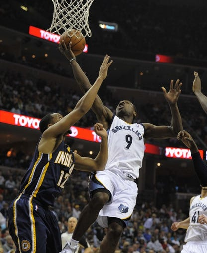 Mar 22, 2014; Memphis, TN, USA; Memphis Grizzlies guard Tony Allen (9) lays the ball up against Indiana Pacers forward Evan Turner (12) during the game at FedExForum. Memphis Grizzlies defeat the Indiana Pacers 82 - 71. Mandatory Credit: Justin Ford-USA TODAY Sports