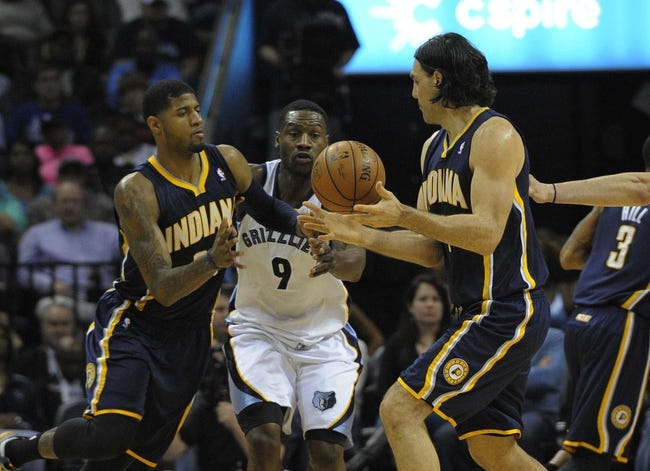 Mar 22, 2014; Memphis, TN, USA; Memphis Grizzlies guard Tony Allen (9) guards Indiana Pacers forward Paul George (24) during the game at FedExForum. Memphis Grizzlies defeat the Indiana Pacers 82 - 71. Mandatory Credit: Justin Ford-USA TODAY Sports