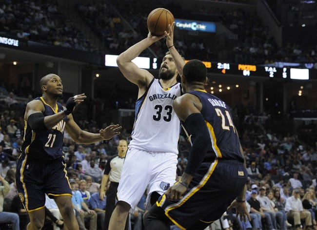 Mar 22, 2014; Memphis, TN, USA; Memphis Grizzlies center Marc Gasol (33) shoots over Indiana Pacers forward Paul George (24) during the game at FedExForum. Memphis Grizzlies defeat the Indiana Pacers 82 - 71. Mandatory Credit: Justin Ford-USA TODAY Sports