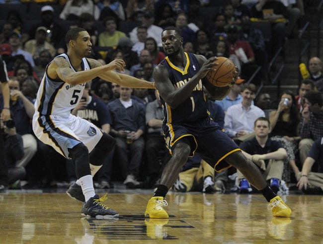Mar 22, 2014; Memphis, TN, USA; Indiana Pacers guard Lance Stephenson (1) handles the ball against Memphis Grizzlies guard Courtney Lee (5) during the game at FedExForum. Memphis Grizzlies defeat the Indiana Pacers 82 - 71. Mandatory Credit: Justin Ford-USA TODAY Sports