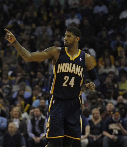 Mar 22, 2014; Memphis, TN, USA; Indiana Pacers forward Paul George (24) during the game against the Memphis Grizzlies at FedExForum. Memphis Grizzlies defeat the Indiana Pacers 82 - 71. Mandatory Credit: Justin Ford-USA TODAY Sports