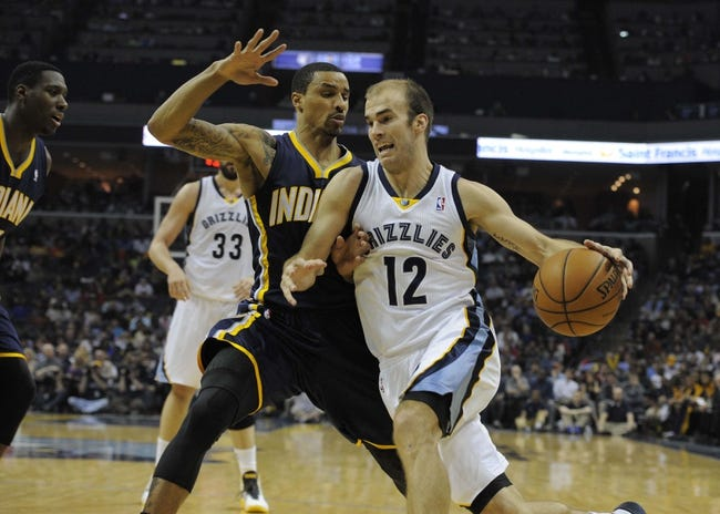 Mar 22, 2014; Memphis, TN, USA; Memphis Grizzlies guard Nick Calathes (12) drives to the basket against Indiana Pacers guard George Hill (3) during the game at FedExForum. Memphis Grizzlies defeat the Indiana Pacers 82 - 71. Mandatory Credit: Justin Ford-USA TODAY Sports