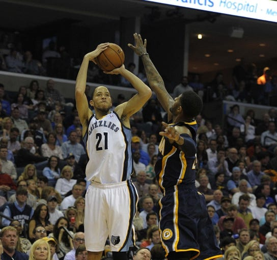 Mar 22, 2014; Memphis, TN, USA; Memphis Grizzlies forward Tayshaun Prince (21) shoots over Indiana Pacers forward Paul George (24) during the game at FedExForum. Memphis Grizzlies defeat the Indiana Pacers 82 - 71. Mandatory Credit: Justin Ford-USA TODAY Sports