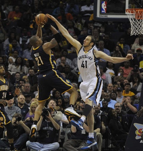 Mar 22, 2014; Memphis, TN, USA; Memphis Grizzlies center Kosta Koufos (41) attempts to block the shoot of Indiana Pacers forward David West (21)  at FedExForum. Memphis Grizzlies defeat the Indiana Pacers 82 - 71. Mandatory Credit: Justin Ford-USA TODAY Sports