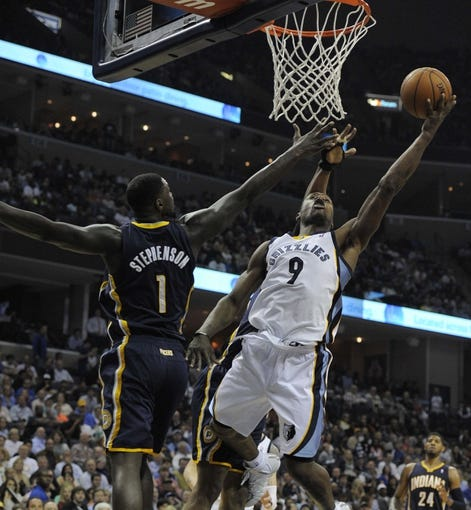 Mar 22, 2014; Memphis, TN, USA; Memphis Grizzlies guard Tony Allen (9) lays the ball up over Indiana Pacers guard Lance Stephenson (1) during the game at FedExForum. Memphis Grizzlies defeat the Indiana Pacers 82 - 71. Mandatory Credit: Justin Ford-USA TODAY Sports