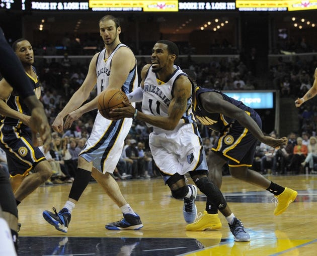 Mar 22, 2014; Memphis, TN, USA; Memphis Grizzlies guard Mike Conley (11) drives past Indiana Pacers guard Lance Stephenson (1) during the game at FedExForum. Memphis Grizzlies defeat the Indiana Pacers 82 - 71. Mandatory Credit: Justin Ford-USA TODAY Sports