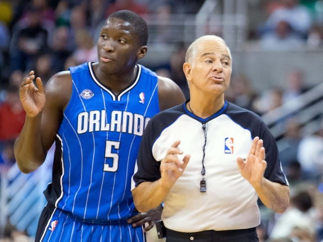 Mar 22, 2014; Salt Lake City, UT, USA; Orlando Magic guard Victor Oladipo (5) talks with referee Bennett Salvatore (15) during the second half against the Utah Jazz at EnergySolutions Arena. The Jazz won 89-88. Mandatory Credit: Russ Isabella-USA TODAY Sports