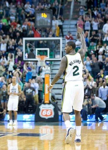 Mar 22, 2014; Salt Lake City, UT, USA; Utah Jazz forward Marvin Williams (2) reacts to a three-point basket by guard Trey Burke (not pictured)  with 1.6 seconds remaining in the second half against the Orlando Magic at EnergySolutions Arena. The Jazz won 89-88. Mandatory Credit: Russ Isabella-USA TODAY Sports