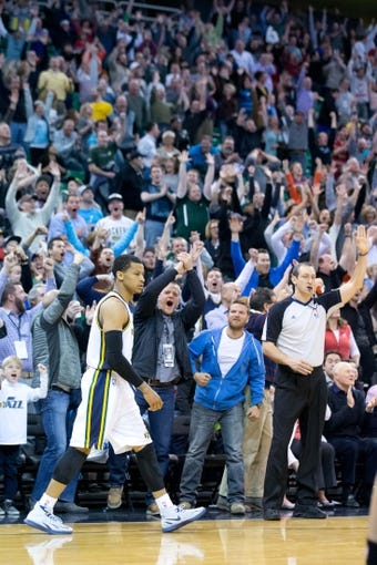 Mar 22, 2014; Salt Lake City, UT, USA; Utah Jazz fans react to a 3-point basket by Utah Jazz guard Trey Burke (3) with 1.6 seconds remaining in the second half against the Orlando Magic at EnergySolutions Arena. The Jazz won 89-88. Mandatory Credit: Russ Isabella-USA TODAY Sports