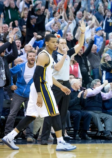 Mar 22, 2014; Salt Lake City, UT, USA; Utah Jazz guard Trey Burke (3) reacts to hitting a go-ahead 3-point shot with 1.6 seconds remaining in the second half against the Orlando Magic at EnergySolutions Arena. The Jazz won 89-88. Mandatory Credit: Russ Isabella-USA TODAY Sports
