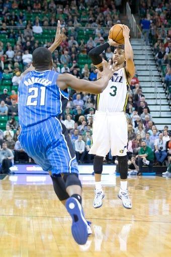 Mar 22, 2014; Salt Lake City, UT, USA; Utah Jazz guard Trey Burke (3) shoots against Orlando Magic forward Maurice Harkless (21) during the second half at EnergySolutions Arena. The Jazz won 89-88. Mandatory Credit: Russ Isabella-USA TODAY Sports