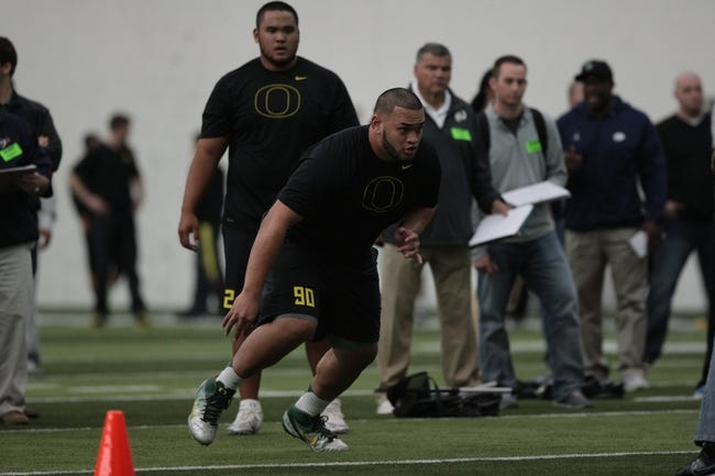 Mar 13, 2014; Eugene, OR, USA; Oregon Ducks defensive tackle Ricky Havili-Heimuli works out in front of NFL scouts at Moshofsky Center. Mandatory Credit: Scott Olmos-USA TODAY Sports