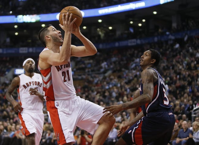 Mar 23, 2014; Toronto, Ontario, CAN; Toronto Raptors guard Greivis Vasquez (21)  goes up to make a basket as Atlanta Hawks guard Louis Williams (3) defends during the first half at the Air Canada Centre. Mandatory Credit: John E. Sokolowski-USA TODAY Sports