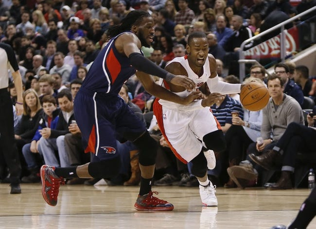 Mar 23, 2014; Toronto, Ontario, CAN; Toronto Raptors guard Terrence Ross (31) drives past Atlanta Hawks forward DeMarre Carroll (5) during the first half at the Air Canada Centre. Mandatory Credit: John E. Sokolowski-USA TODAY Sports