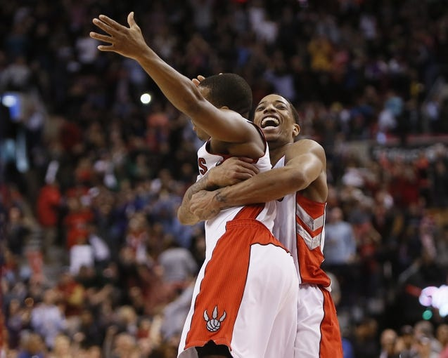 Mar 23, 2014; Toronto, Ontario, CAN; Toronto Raptors guard Kyle Lowry (left) and Toronto Raptors guard DeMar DeRozan (right) celebrate a win over the Atlanta Hawks at the Air Canada Centre. Toronto defeated Atlanta 96-86. Mandatory Credit: John E. Sokolowski-USA TODAY Sports