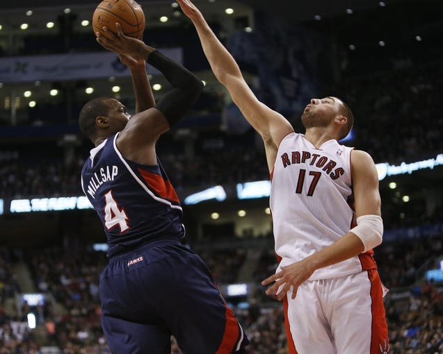 Mar 23, 2014; Toronto, Ontario, CAN; Toronto Raptors center Jonas Valanciunas (17) defends against Atlanta Hawks forward Paul Millsap (4) during the second half at the Air Canada Centre. Toronto defeated Atlanta 96-86. Mandatory Credit: John E. Sokolowski-USA TODAY Sports