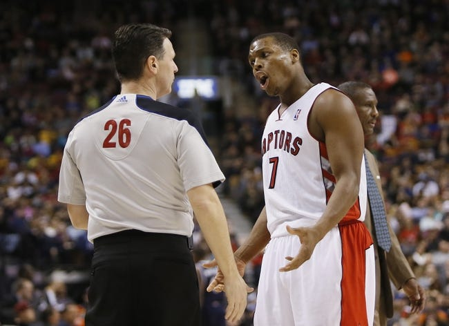 Mar 23, 2014; Toronto, Ontario, CAN; Toronto Raptors guard Kyle Lowry (7) questions a call by official Pat Fraher (26) during the second half against the Atlanta Hawks at the Air Canada Centre. Toronto defeated Atlanta 96-86. Mandatory Credit: John E. Sokolowski-USA TODAY Sports