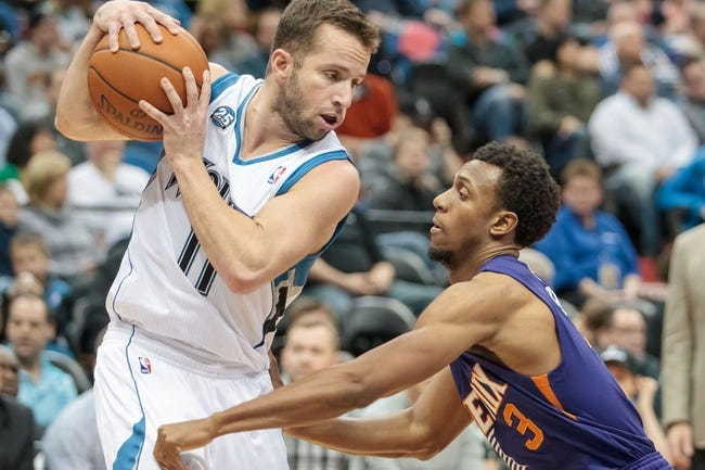 Mar 23, 2014; Minneapolis, MN, USA; Minnesota Timberwolves guard J.J. Barea (11) dribbles in the second quarter against the Phoenix Suns guard Ish Smith (3) at Target Center. Mandatory Credit: Brad Rempel-USA TODAY Sports