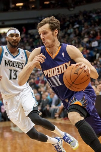 Mar 23, 2014; Minneapolis, MN, USA; Phoenix Suns guard Goran Dragic (1) dribbles in the second quarter against the Minnesota Timberwolves at Target Center. Mandatory Credit: Brad Rempel-USA TODAY Sports