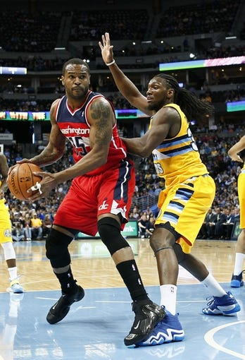 Mar 23, 2014; Denver, CO, USA; Denver Nuggets small forward Kenneth Faried (35) guards Washington Wizards power forward Trevor Booker (35) in the first quarter at the Pepsi Center. Mandatory Credit: Isaiah J. Downing-USA TODAY Sports