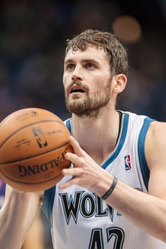 Mar 23, 2014; Minneapolis, MN, USA; Minnesota Timberwolves forward Kevin Love (42) shoots in the third quarter against the Phoenix Suns at Target Center. Phoenix wins 127-120. Mandatory Credit: Brad Rempel-USA TODAY Sports