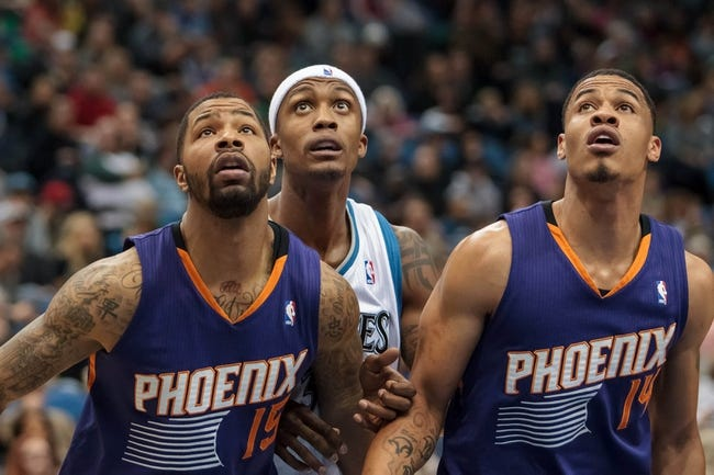 Mar 23, 2014; Minneapolis, MN, USA; Phoenix Suns forward Marcus Morris (15) and guard Gerald Green (14) rebound against Minnesota Timberwolves forward Dante Cunningham (33) in the fourth quarter at Target Center. Phoenix wins 127-120. Mandatory Credit: Brad Rempel-USA TODAY Sports