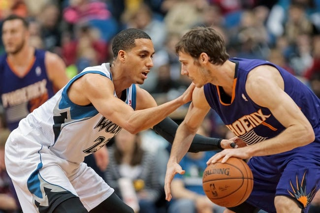 Mar 23, 2014; Minneapolis, MN, USA; Phoenix Suns guard Goran Dragic (1) dribbles in the third quarter against the Minnesota Timberwolves shooting guard Kevin Martin (23) at Target Center. Phoenix wins 127-120. Mandatory Credit: Brad Rempel-USA TODAY Sports