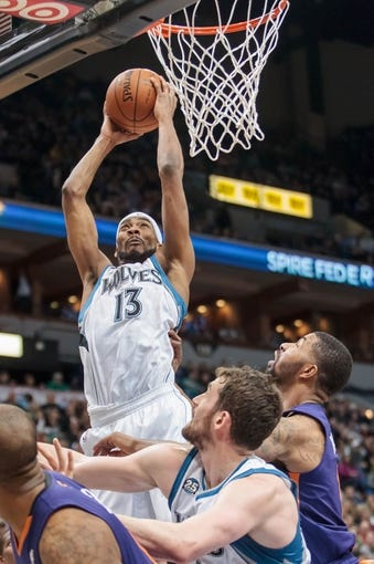 Mar 23, 2014; Minneapolis, MN, USA; Minnesota Timberwolves forward Corey Brewer (13) shoots in the third quarter against the Phoenix Suns at Target Center. Phoenix wins 127-120. Mandatory Credit: Brad Rempel-USA TODAY Sports