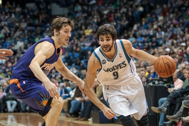 Mar 23, 2014; Minneapolis, MN, USA; Minnesota Timberwolves guard Ricky Rubio (9) dribbles in the fourth quarter against the Phoenix Suns guard Goran Dragic (1) at Target Center. Phoenix wins 127-120. Mandatory Credit: Brad Rempel-USA TODAY Sports